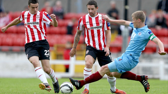 Drogheda's Derek Pendergast goes in on Derry's Michael Duffy