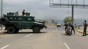 Yemeni soldiers search a motorbike at a checkpoint on a street leading to the US embassy compound in Sanaa