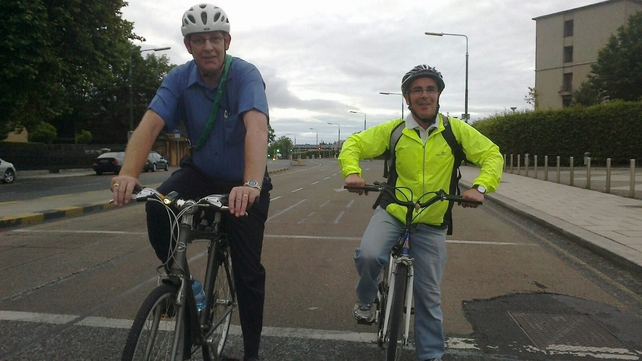 Dan Burke and Jim Lehane cycle to work as the bus strike continues