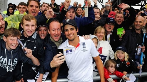 Alastair Cook poses with England fans after retaining the Ashes