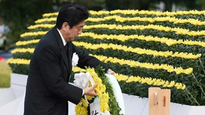 Japanese Prime Minister Shinzo Abe lays a wreath at Hiroshima Peace Park