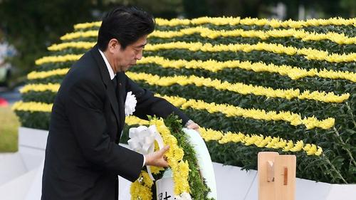 Japanese Prime Minister Shinzo Abe lays a wreath at Hiroshima Peace Park
