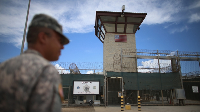 An officer stands outside Camp VI of the US military detention facility at Guantanamo Bay