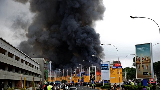 Huge plumes of black smoke billowed from the airport buildings