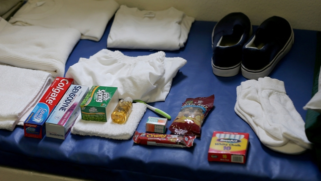 A static display shows the belongings of a typical inmate in a prison cell