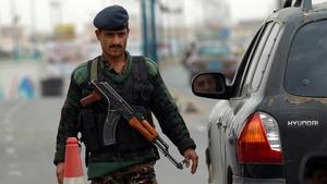 A Yemeni soldier checks vehicles near Sanaa International Airport yesterday
