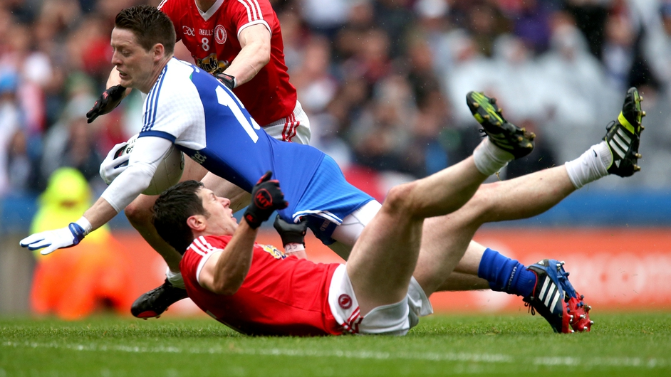 Monaghan's Conor McManus is tackled by Sean Cavanagh of Tyrone during Saturday's All Ireland quarter final in Croke Park