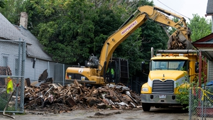 Demolition crews clear the remains of the home where Ariel Castro held three women captive in Cleveland, Ohio