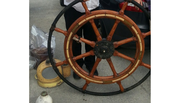 Divers located the ship's wheel and compass