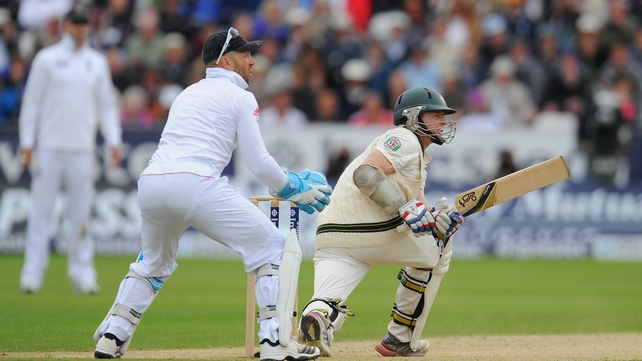 Chris Rogers reaches his century with a sweep for four watched by Matt Prior