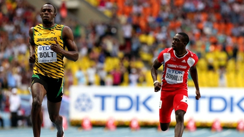 Usain Bolt safely through as he bids to make amends for Daegu in 2011