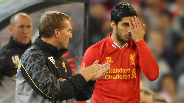 Brendan Rodgers wants Luis Suarez to apologise to his team-mates and the club
