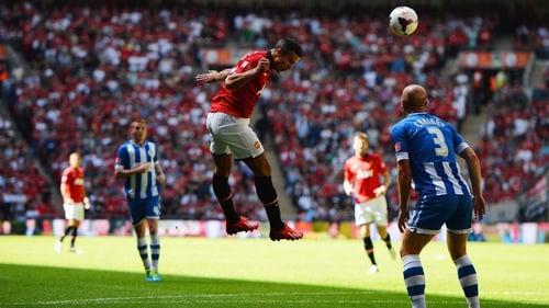 Robin van Persie heads home United's opening goal