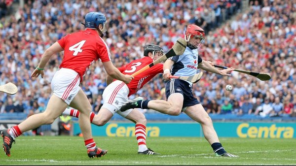 Cork secured a five-point victory over 14-man Dublin