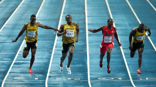 Usain Bolt crosses the line to win the 100m world title
