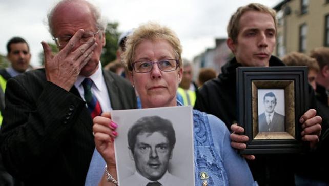 Loyalist protesters hold pictures of IRA victims during a parade in Castlederg earlier today