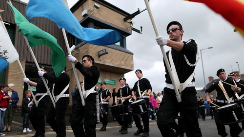 Sinn Féin supporters parade past Castlederg PSNI station earlier this afternoon
