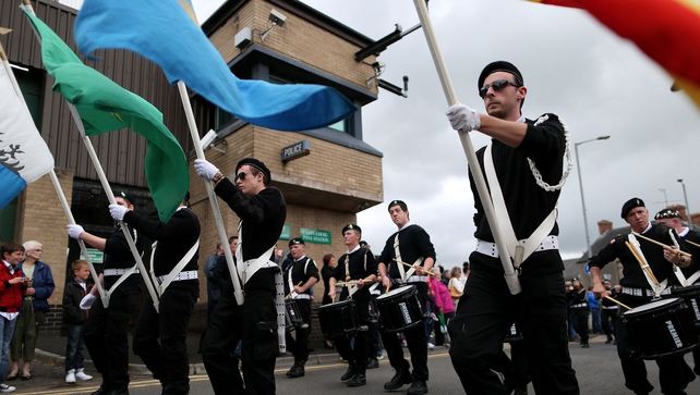Sinn Féin supporters parade past Castlederg PSNI station earlier this afternoon