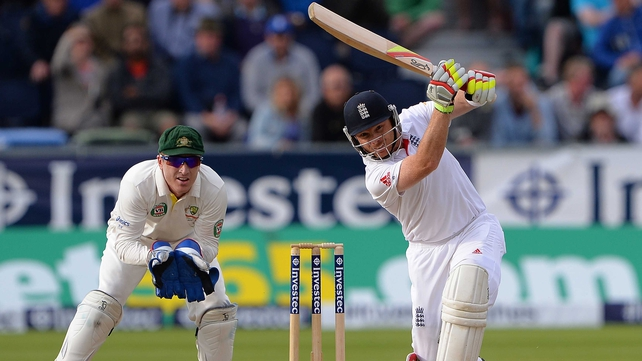 Ian Bell (R) hits a boundary, watched by Australia's Brad during play on the third day of the fourth Test match