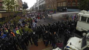 56 police officers and two civilians were hurt in violent protests in Belfast on Friday