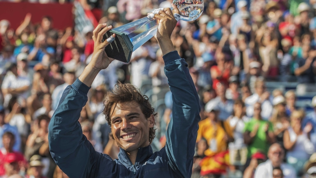 Rafael Nadal hoists the Rogers Cup trophy after beating local favourite Milos Raonic in Montreal