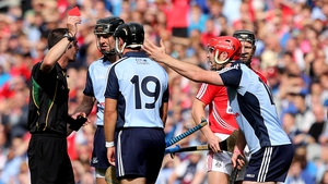 Referee James Owen brandishes a red card to Ryan O'Dwyer