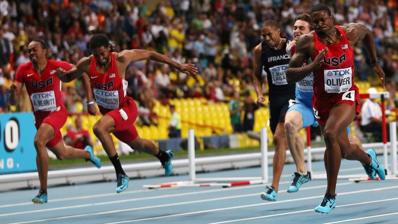 David Oliver (right) wins the men's 110m hurdles final at the 2013 IAAF World Championships