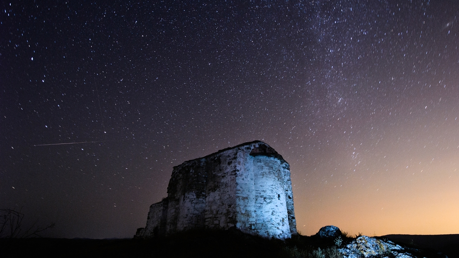 A long-exposure shot of the Perseids over a medieval church in Bulgaria