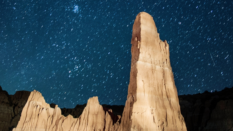 A meteor streaks across the sky above Cathedral Gorge State Park in Nevada, US
