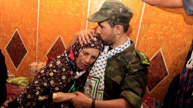Freed Palestinian prisoner Salah al-Sahair kisses his mother following his return to Gaza