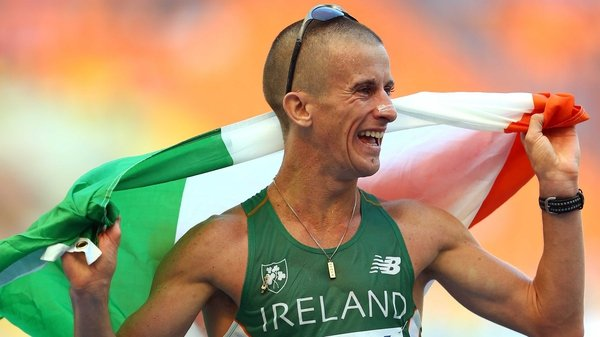Rob Heffernan celebrates with the tri-colour after winning gold in the 50km walk at the World Athletics Championships