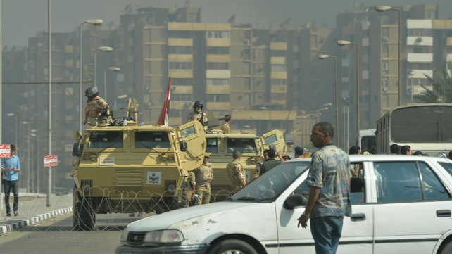 Egyptian military vehicles block a road leading to the Rabaa al-Adawiya protest camp