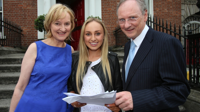 Ciara Walsh celebrates her results with her parents Marie and Michael at Loreto College in Dublin