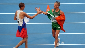 Rob Heffernan is congratulated by Russia's second place finisher Mikhail Ryzhov