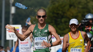 Rob Heffernan cools down mid-race with second place finisher Mikhail Ryzhov in the background