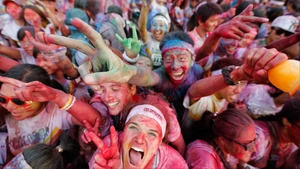 Competitors celebrate completing the Colour Run in Beijing, China