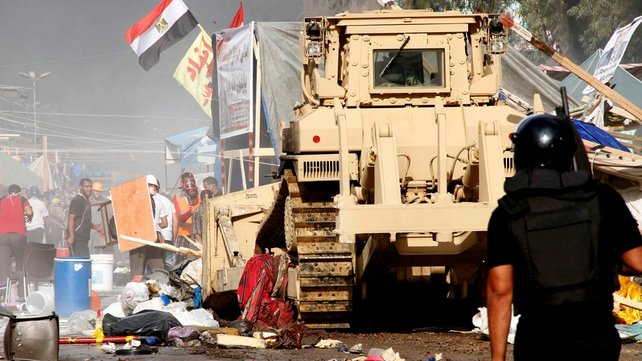 Egyptian security forces moved in to disperse near Cairo's Rabaa al-Adawiya mosque