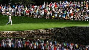 Adam Scott of Australia walks across the 15th green during the 95th PGA Championship in Rochester, New York