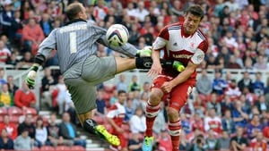 Lukas Jutkiewicz of Middlesbrough takes the pain to score past Ian Dunbavin of Accrinton Stanley in the Capital One Cup in Middlesbrough, England