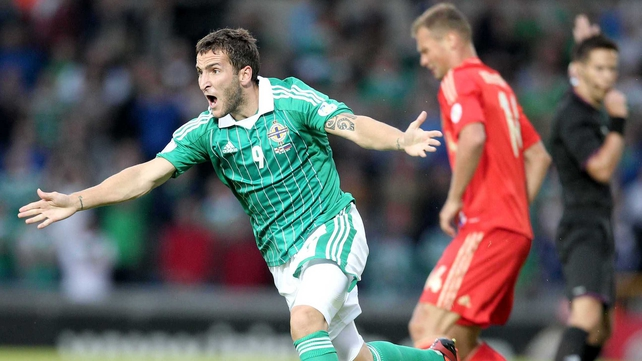 Northern Ireland's Niall McGinn with Russia's Vasilyi Berezutskyi