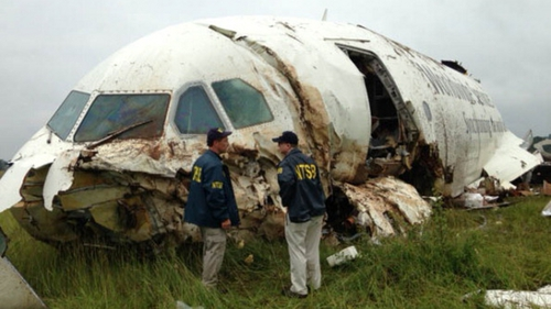 NTSB workers inspect the wreckage of the UPS cargo plane