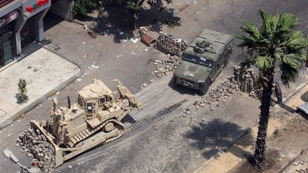 Army bulldozers remove a barricade at Cairo's Mustafa Mahmoud Square
