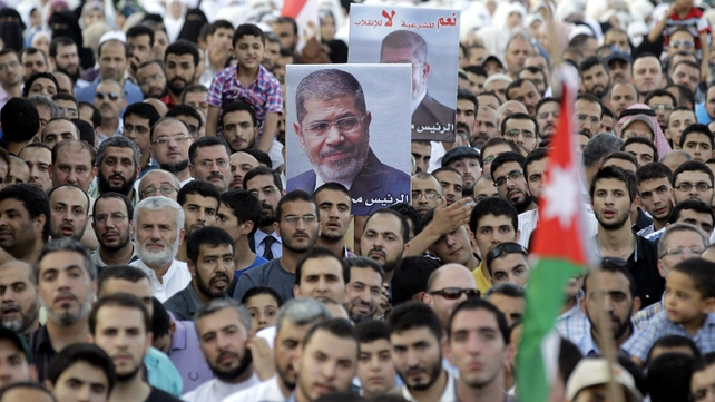 Protesters from the Islamic Action Front rally in support of Mohammed Mursi  near the Egyptian embassy in the Jordanian capital Amman