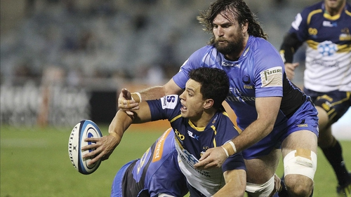Matt Toomua offloads during a Super Rugby match between the Brumbies and the Force