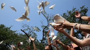 Japanese people release doves to mark the 68th anniversary of their surrender in World War II