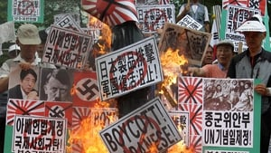 South Korean protesters burn anti-Japanese signs following controversial remarks by Japanese Prime Minister Shinzo Abe