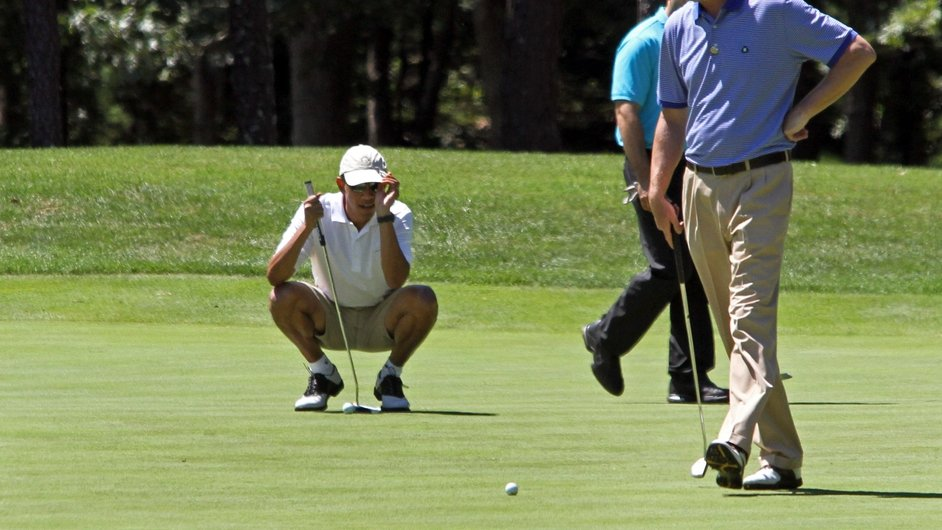 President Barack Obama lines up a putt while on a family holiday to Martha's Vineyard