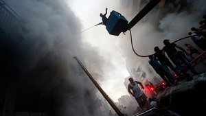 The blast sent a column of black smoke over the city