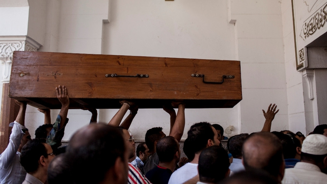 A coffin is carried inside the al-Amin mosque in Cairo