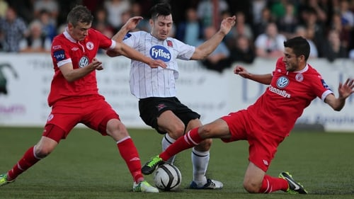 Richie Towell is challenged by Jeff Henderson and Seamus Conneely